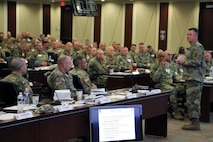"""Gen. Paul E. Funk II, commanding general, U.S. Army Training and Doctrine Command, speaks with U.S. Army #FORSCOM commanders and command sergeants major about """"unity of effort, unity of command"""" as part of the commander's forum, Nov. 14, at Fort Bragg, N.C. (Photo Credit: Ms. Eve Meinhardt)"""