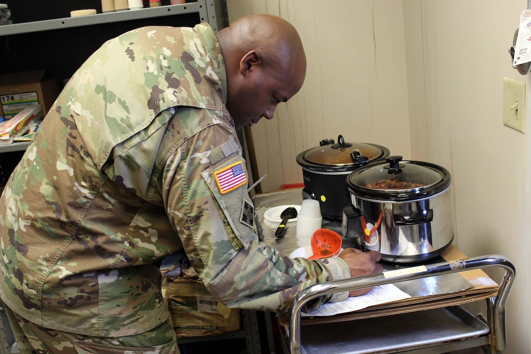 Army Maj. Lionel Macklin, program manager for combat feeding in the Subsistence supply chain at the Defense Logistics Agency Troop Support, judges samples during a workforce chili cook-off. The event, held at DLA Troop Support headquarters in Philadelphia, is an annual awareness event for the Combined Federal Campaign.