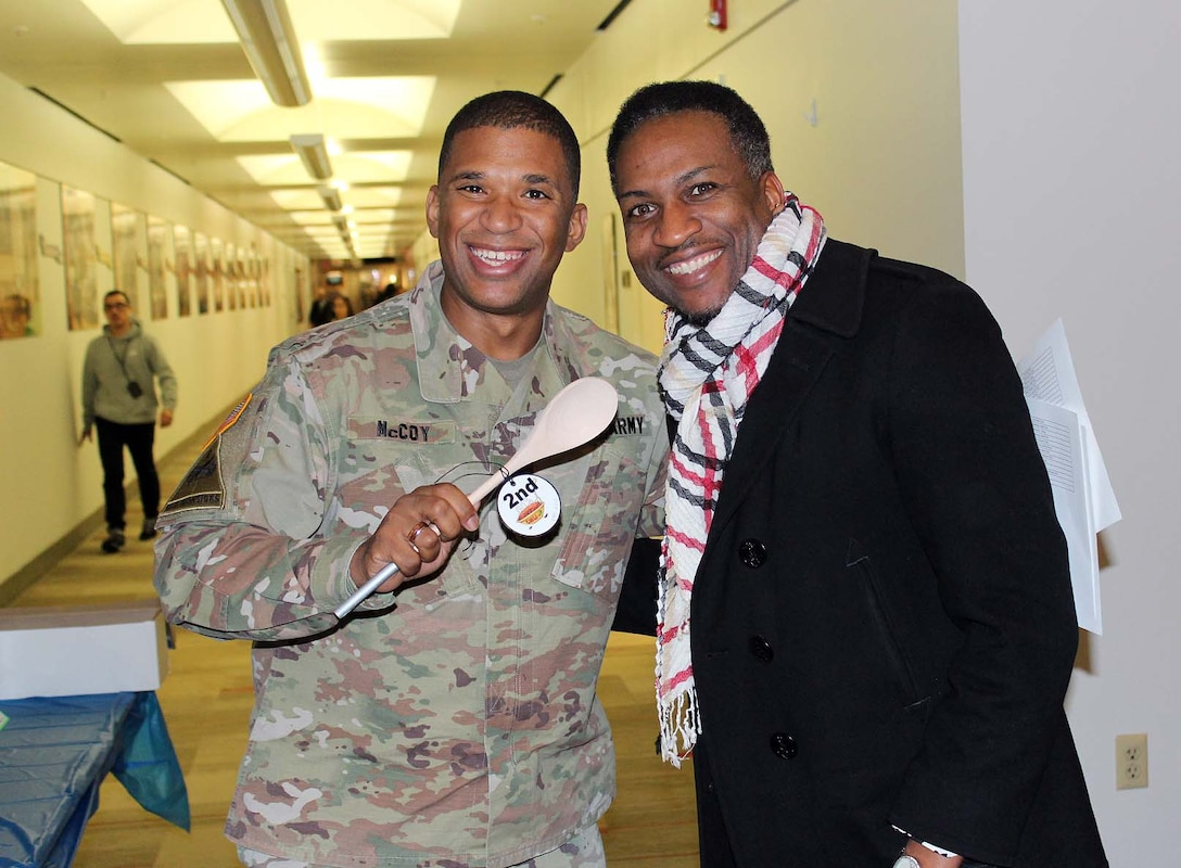 Army Col. Eric McCoy, left, director of the Subsistence supply chain at the Defense Logistics Agency Troop Support in Philadelphia, awards second place prize for the chili cook-off to John Lewis, a data architect in the Medical supply chain. The cook-off was held on Nov. 20 at DLA Troop Support headquarters in Philadelphia, and is an annual awareness event for the Combined Federal Campaign.
