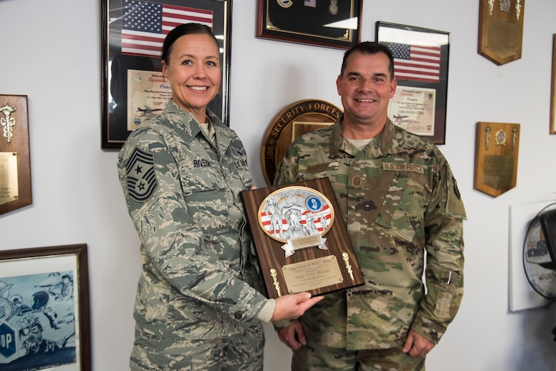 Command Chief Masfter Sgt. Holly R. RIvera, the 108th Wing command chief, left, presents the Chief Master Sgt. Edward W. Wolbert Oustanding First Sergeant Award to Master Sgt. John Mauger, the 108th Medical Group first sergeant, at Joint Base McGuire-Dix-Lakehurst, N.J., Nov. 16, 2019. Mauger was selected as the award winner on Aug. 9, 2019 by the Enlisted Association of the National Guard of New Jersey. (U.S. Air National Guard photo by Senior Airman Julia Santiago)