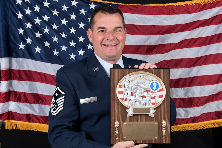 Master Sgt. John Mauger, the 108th Medical Group first sergeant, holds the Chief Master Sgt. Edward W. Wolbert Oustanding First Sergeant Award at Joint Base McGuire-Dix-Lakehurst, N.J., Nov. 17, 2019. Mauger was selected as the award winner on Aug. 9, 2019 by the Enlisted Association of the National Guard of New Jersey. (U.S. Air National Guard photo by Senior Airman Julia Santiago)
