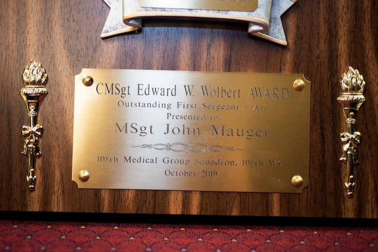 The Chief Master Sgt. Edward W. Wolbert Oustanding First Sergeant Award, given to Master Sgt. John Mauger, the 108th Medical Group first sergeant, sits in the headquarters building at Joint Base McGuire-Dix-Lakehurst, N.J., Nov. 17, 2019.  Mauger was selected as the award winner on Aug. 9, 2019 by the Enlisted Association of the National Guard of New Jersey. (U.S. Air National Guard photo by Senior Airman Julia Santiago)