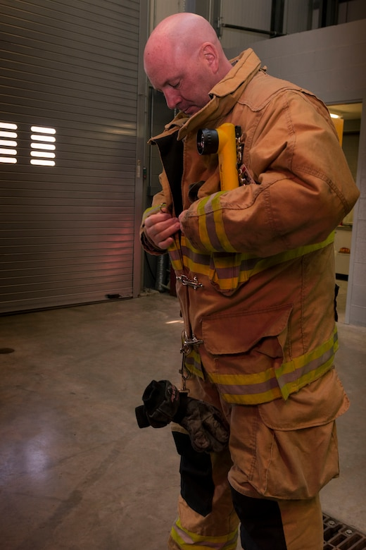 Tech. Sgt. Ronald Avery, firefighter with Bradley Air National Guard Base, adjusts his Personal Protection Equipment (PPE) Nov. 3, 2019 at the Bradley Air National Guard Fire Department, East Granby, Conn. Avery was one of the firefighters from Bradley who responded to the B-17 Flying Fortress crash Oct. 2, 2019. (U.S. Air National Guard photo by Airman 1st Class Chanhda Ly)
