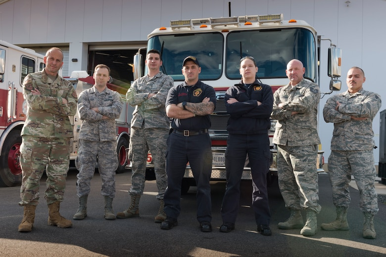 (From left to right) Chief Master Sgt. Robert Cross, Tech. Sgt. Craig Bein, Senior Airman Jason Conway, Firefighter Howard Corp, Firefighter Lisa Deakins, Tech. Sgt Ronald Avery, and Senior Airman Gabriel Pagan pose in front of the Bradley Air National Guard Base Fire Station Nov. 3, 2019 East Granby, Conn. These firefighters all responded to the B-17 Flying Fortress crash at Bradley International Airport Oct. 2, 2019. (U.S. Air National Guard photo by Airman 1st Class Chanhda Ly)