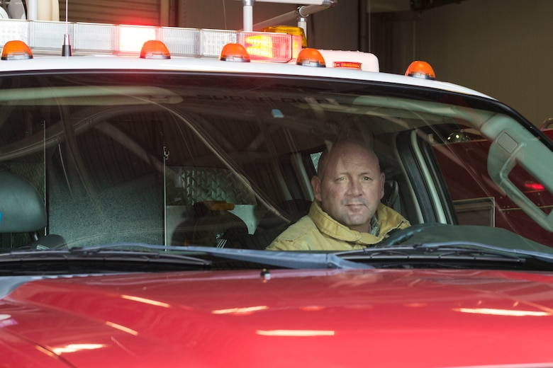 Tech. Sgt. Ronald Avery, Connecticut Air National Guard firefighter, prepares to drive the rescue truck from the Bradley Air National Guard Base Fire Station Nov. 3, 2019. Firefighters at Bradley train consistently with the firefighters with the Bradley International Airport Fire Department, which ultimately aided their quick stabilization of the B-17 Flying Fortress crash that occurred Oct. 2, 2019. (U.S. Air National Guard photo by Airman 1st Class Chanhda Ly)