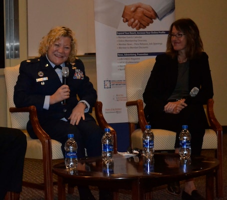 "Air Force Reserve Lt. Col. Susan McMullen, DLA Troop Support Project Manager, left, sits beside FBI Special Agent Cerena Coughlin, right, as she shares her personal story of being a woman in the military during the Greater Northeast Philadelphia Chamber of Commerce annual Women in Industry Day event Nov. 20, 2019 at Holy Family University in Philadelphia. The Women in Industry Day event aims to ""broaden the conversation"" and expose women to various career opportunities. McMullen served as a panelist during the ""women in male-dominated industries"" discussion. (Photo by Alexandria Brimage-Gray)"