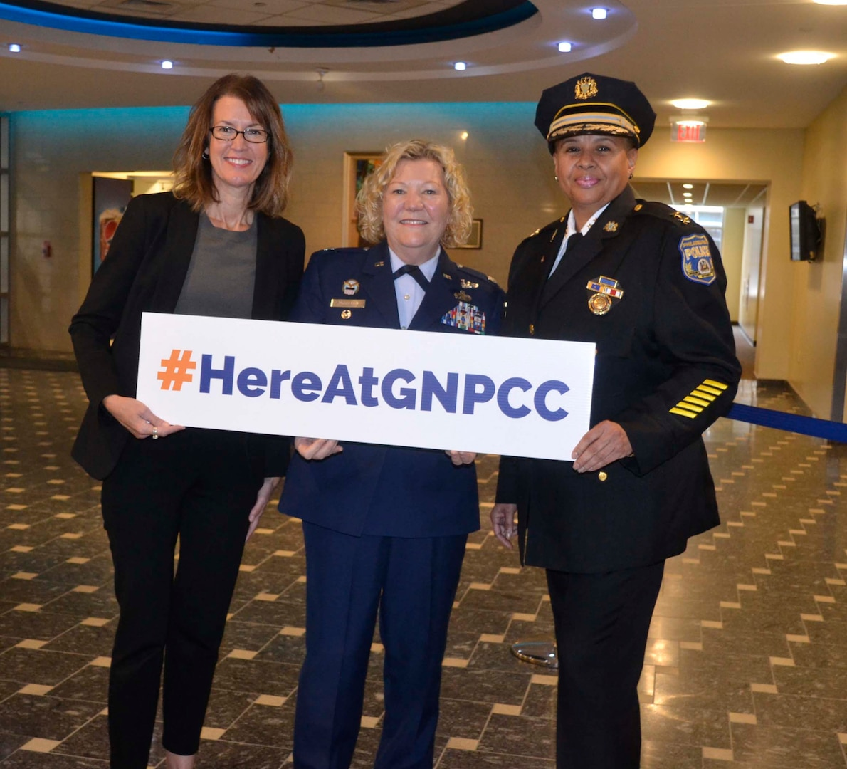 """FBI Special Agent Cerena Coughlin, left, DLA Troop Support Project Manager Air Force Reserve Lt. Col. Susan McMullen, center and City of Philadelphia Police Department Deputy Commissioner Robin Wimberly, right, pose for a photo after the Greater Northeast Philadelphia Chamber of Commerce annual Women in Industry Day event Nov. 20, 2019 at Holy Family University in Philadelphia. The Women in Industry Day event aims to """"broaden the conversation"""" and expose women to various career opportunities. The ladies served as the panelists during the """"women in male-dominated industries"""" discussion. (Photo by Alexandria Brimage-Gray)"""
