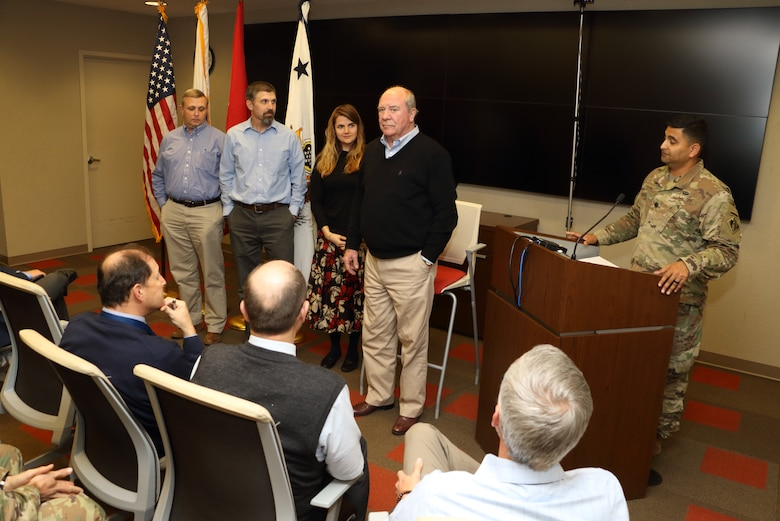R.D. James (Right), assistant secretary of the Army for Civil Works, recognizes (Left to Right) Tim Dunn, deputy chief of Operations Division; Eric Pagoria, Construction Branch chief; and Kirsten Ronholt, Office of Counsel, for excellence during a town meeting Nov. 14, 2019 at the district's headquarters in Nashville, Tenn. (USACE Photo by Mark Abernathy)