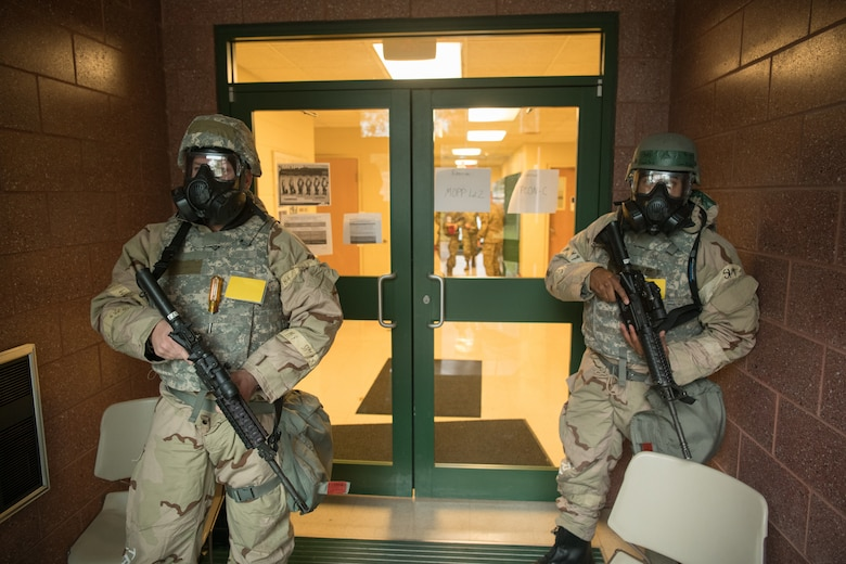 airmen in MOPP gear respond to a simulated threat