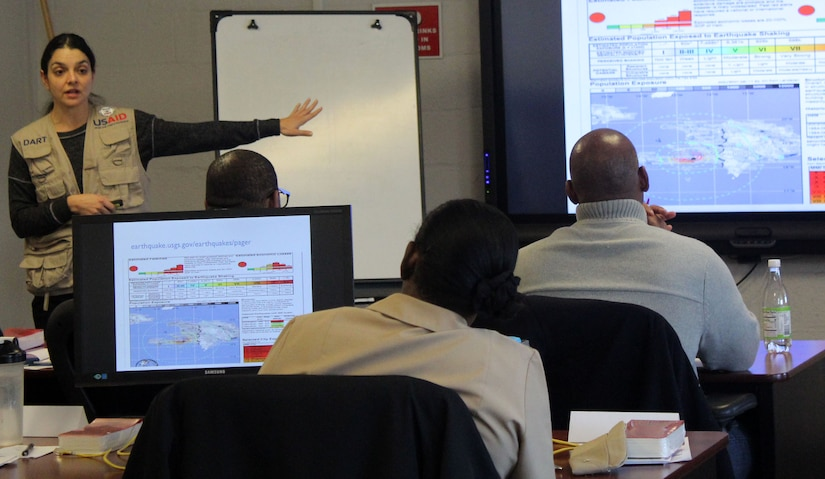 Nina Kessler, a U.S. Agency for International Development Office of U.S. Foreign Disaster Assistance humanitarian assistance advisor, speaks to a class during a Joint Humanitarian Operations Course at DLA Troop Support Nov. 13, 2019 in Philadelphia.