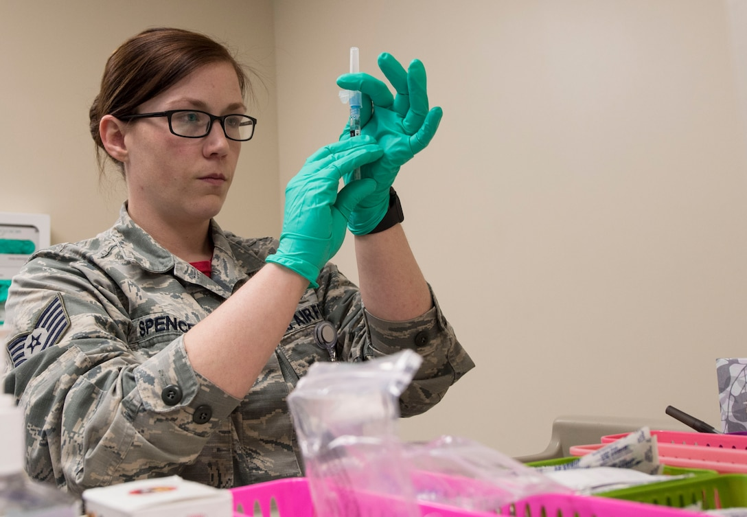 U.S. Air Force Tech. Sgt. Jake Spencer, 20th Healthcare Operations Squadron noncommissioned officer in charge of immunizations, prepares to administer a flu shot at Shaw Air Force Base, South Carolina, Nov. 11, 2019.