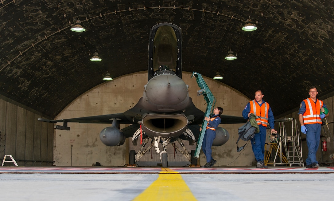 Hellenic service members from the 335th Fighter Squadron prepare an F-16 Fighting Falcon for take off during Blue Flag 2019 at Uvda Air Base, Israel, November 7, 2019. The three member team worked together to prepare the F-16 for participation in the day's training exercises. (U.S. Air Force photo by Airman 1st Class Kyle Cope)