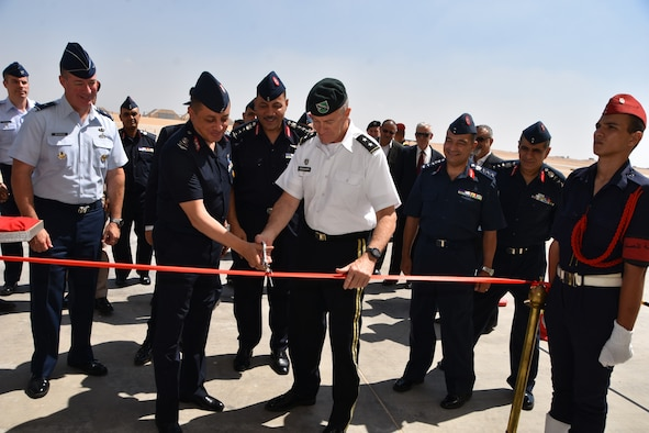 A ribbon cutting ceremony at Cairo West Air Base, marking the completion of a $184 million construction project and delivery of 20 F-16s. U.S. Air Force Brig. Gen Brian Bruckbauer (left), director of the Air Force Security Assistance and Cooperation Directorate, and U.S. Army Maj. Gen. Ralph Groover III (middle right) the Senior Defense Official, United States Embassy, Cairo Egypt, attended the event.