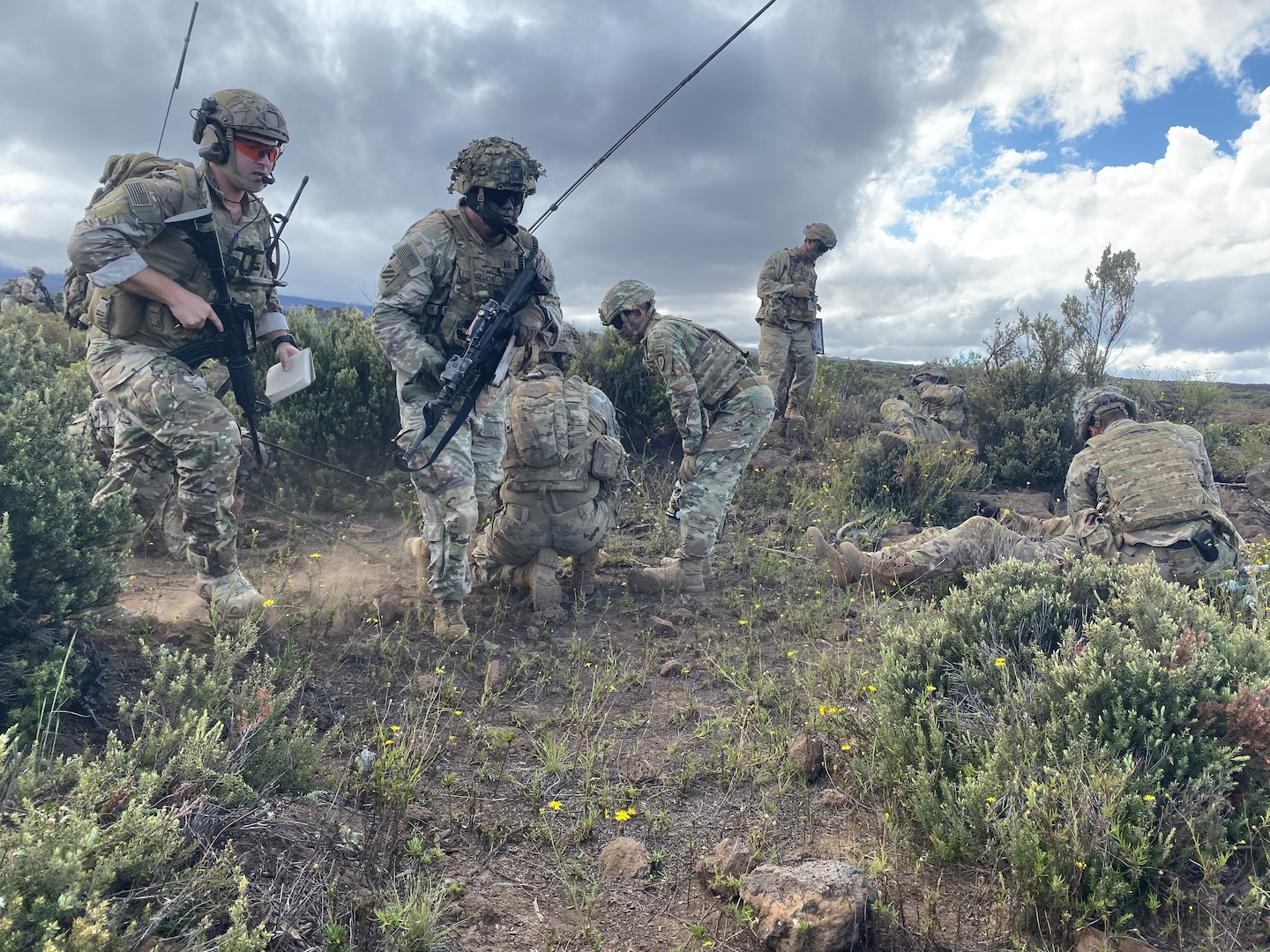Staff Sgt. Ryan Dillman, 25th Air Support Operations Squadron Tactical Air Control Party, maneuvers toward the assaulting platoon with Alpha Company while coordinating a Medical Evacuation nine-line for a notional casualty while Observer Controllers/Trainers stand by during a Fire Support Coordination Exercise on Pohakuloa Training Area, located on the big island of Hawaii, November 12 through 21, 2019. During the exercise, members of the 25th ASOS and U.S. Army Pacific 2nd Brigade, 25th Infantry Division, 2nd Brigade Combat Team, integrated with B-52 Stratofortress bombers for live-fire training missions in support of Indo-Pacific Command's Continuous Bomber Presence operations. (Courtesy photo)