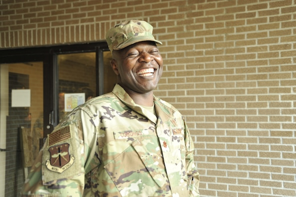 Major Bitrus B. Cobongs, 403rd Wing Chaplain smiles as he prepares to attend a 403rd Wing Staff meeting, Oct. 5, 2019 at Keesler Air Force Base, Miss. Cobongs advises leadership on religious and spiritual matters, moral welfare, conducts unit ministry, counseling, and pastoral care for the Reserve Citizen Airmen of 403rd Wing. (U.S. Air Force photo by TSgt. Michael Farrar)