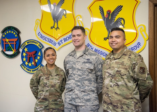From left, Master Sgt. Joy McCammon, 718th Force Support Squadron casualty operations section chief, Staff Sgt. Alexander Nestle, 18th Communications Squadron software development supervisor, and Tech. Sgt. Christopher Sills, 18th CS NCO in charge of application development, stand for a photo at Kadena Air Base, Japan, Nov. 19, 2019. They are part of the PRAS team named as one of two U.S. Pacific Air Forces Spark Tank nominees to compete at the Air Force level. (U.S. Air Force Photo by Airman 1st Class Mandy Foster)