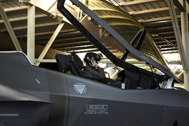 An F-35A pilot with the 388th Fighter Wing dons his helmet prior to launch at Hill Air Force Base, Utah on Nov. 13, 2019. The 34th Fighter Squadron departed Hill for Al Dhafra Air Base, United Arab Emirates, to support the United States Air Force Central Command mission in the MIddle East. The group of deploying Airmen was made up of pilots from the active duty 34th Fighter Squadron and Reserve 466th Fighter Squadron, as well as active duty and Reserve Airmen in the 34th Aircraft Maintenance Unit, and personnel in other support functions. (U.S. Air Force photo by R. Nial Bradshaw)