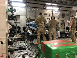 Air National Guard Critical Care Air Transport Team, deployed from the 125th Medical Group, Jacksonville Air National Guard Base, Florida, give medical attention to a patient during their six-month deployment to Bagram Airfield, Afghanistan.