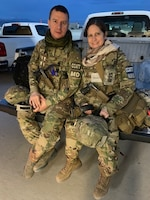 U.S. Air Force Maj. Andrew Kurklinsky, Critical Care Air Transport Team physician and officer in charge, and U.S. Air Force Maj. Tracy Provenzano, a CCATT nurse pose for a photo during their six-month deployment to Bagram Airfield, Afghanistan.