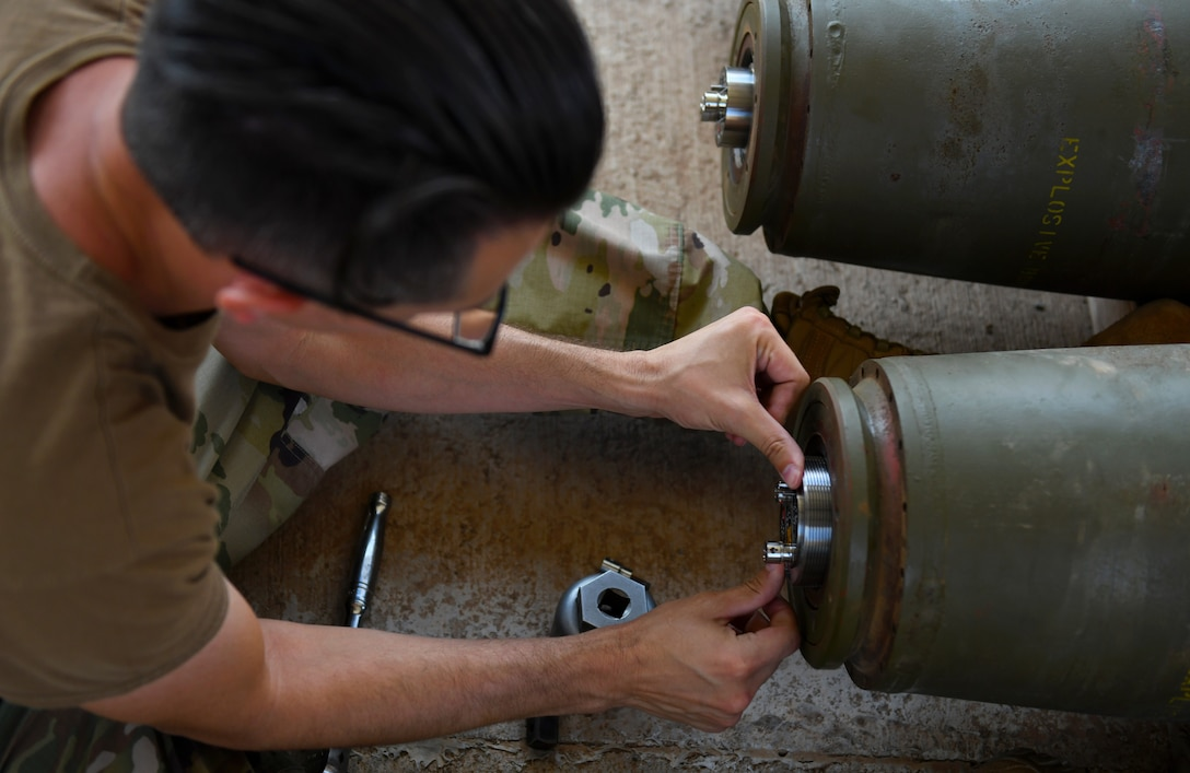 U.S. Air Force Tech. Sgt. Brandon Coleman, 726th Expeditionary Air Base Squadron munitions production supervisor, installs a fuse assembly during a bomb build at Chabelley Airfield, Djibouti, Nov. 12, 2019. The 726th EABS Munitions Systems Airmen build, inspect and store all munitions at the airfield, ensuring mission effectiveness at a moment's notice. (U.S. Air Force photo by Staff Sgt. Alex Fox Echols III)