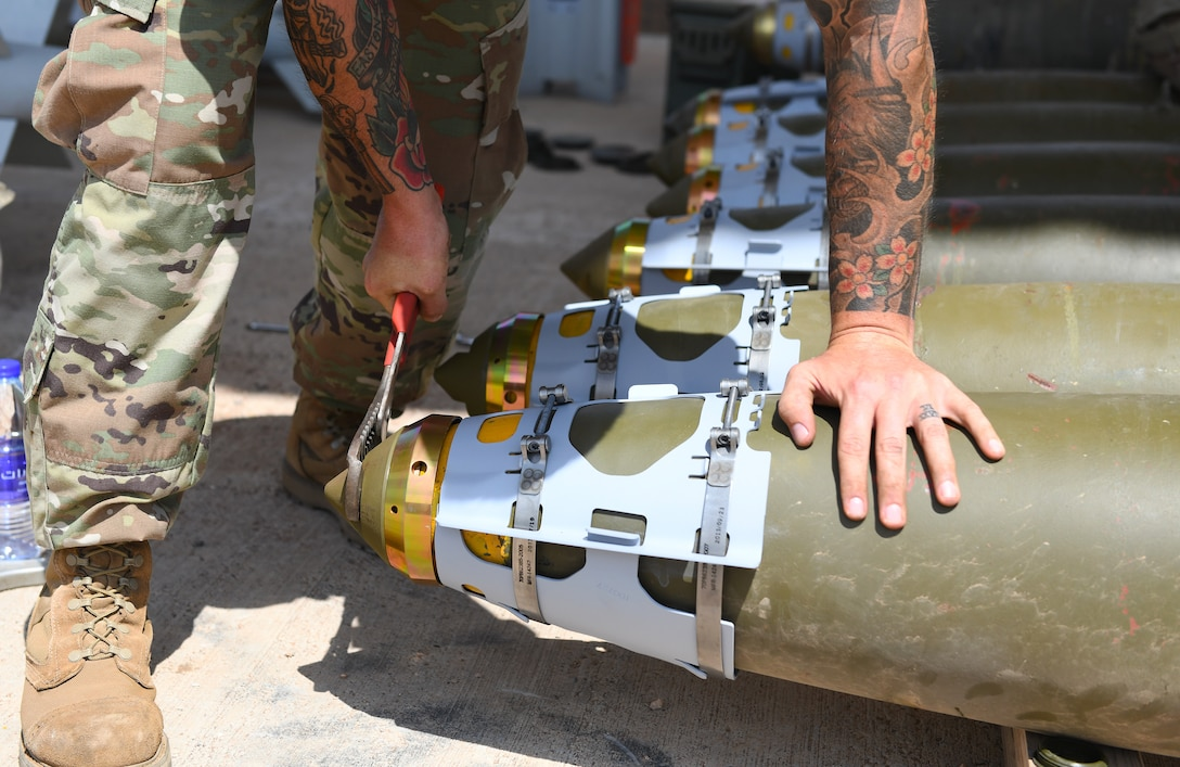U.S. Air Force Tech. Sgt. Brandon Coleman, 726th Expeditionary Air Base Squadron senior munitions inspector, assembles the nose of munitions during a bomb build at Chabelley Airfield, Djibouti, Nov. 12, 2019. The 726th EABS Munitions Systems Airmen build, inspect and store all munitions at the airfield, ensuring mission effectiveness at a moment's notice. (U.S. Air Force photo by Staff Sgt. Alex Fox Echols III)