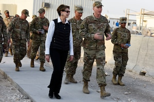 Secretary of the Air Force Barbara Barrett speaks with Maj. Logan Jergens, 379th Expeditionary Force Support Squadron, during a walking tour at Al Udeid Air Base, Qatar on Nov. 17, 2019. During their first overseas trip, Barrett and Air Force Chief of Staff Gen. David L. Goldfein met with AUAB and Qatari leadership, held an all-call where they spoke to readiness, lethality and the future of the U.S. Air Force and visited Airmen and the facilities where they work and live. (U.S. Air Force photo by Tech. Sgt. Ian Dean)