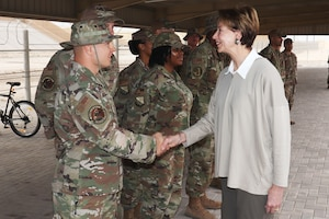Secretary of the Air Force Barbara Barrett presents the SECAF coin to Staff Sgt. Joshua Maurer, 8th Expeditionary Aircraft Maintenance Squadron, at Al Udeid Air Base, Qatar on Nov. 18, 2019. During their first overseas trip, Barrett and Air Force Chief of Staff Gen. David L. Goldfein met with AUAB and Qatari leadership, held an all-call where they spoke to readiness, lethality and the future of the U.S. Air Force and visited Airmen and the facilities where they work and live.(U.S. Air Force photo by Tech. Sgt. Ian Dean)
