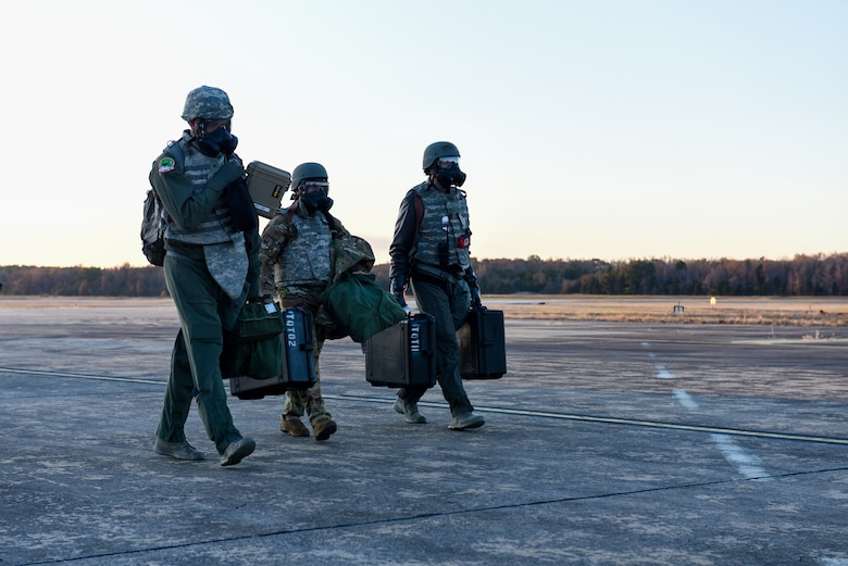 Aircrew walks away from a plane wearing gas masks
