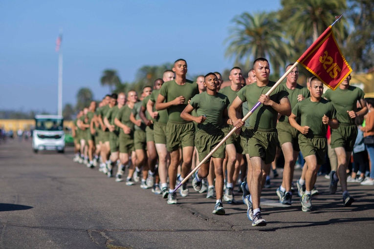 A group of Marines run together.