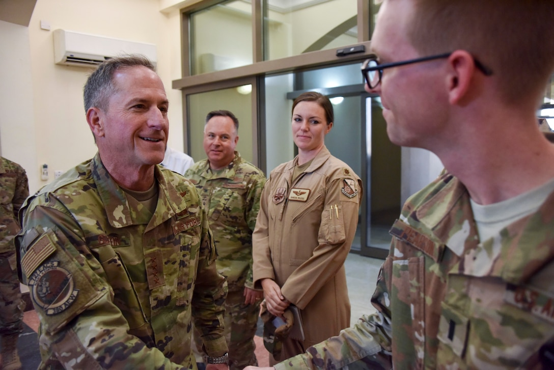 Air Force Chief of Staff Gen. David L. Goldfein speaks with an Airman after arriving at Al Udeid Air Base, Qatar on Nov. 17, 2019. During their first overseas trip, Secretary of the Air Force Barbara Barrett and Goldfein met with AUAB and Qatari leadership, held an all-call where they spoke to readiness, lethality and the future of the U.S. Air Force and visited Airmen and the facilities where they work and live. (U.S. Air Force photo by Tech. Sgt. John Wilkes)
