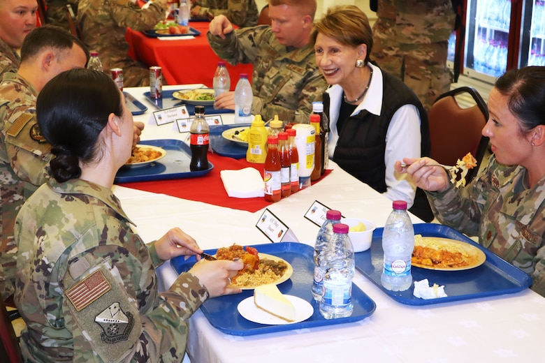 Secretary of the Air Force Barbara Barrett speaks with airmen who are deployed for the first time during a dinner at Blatchford-Preston Complex dinning facility at Al Udeid Air Base, Qatar on Nov. 17, 2019. During their first overseas trip, Barrett and Air Force Chief of Staff Gen. David L. Goldfein met with AUAB and Qatari leadership, held an all-call where they spoke to readiness, lethality and the future of the U.S. Air Force and visited Airmen and the facilities where they work and live.(U.S. Air Force photo by Tech. Sgt. Ian Dean)