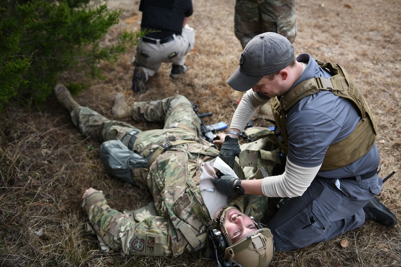 an airman performs simulated medical treatment