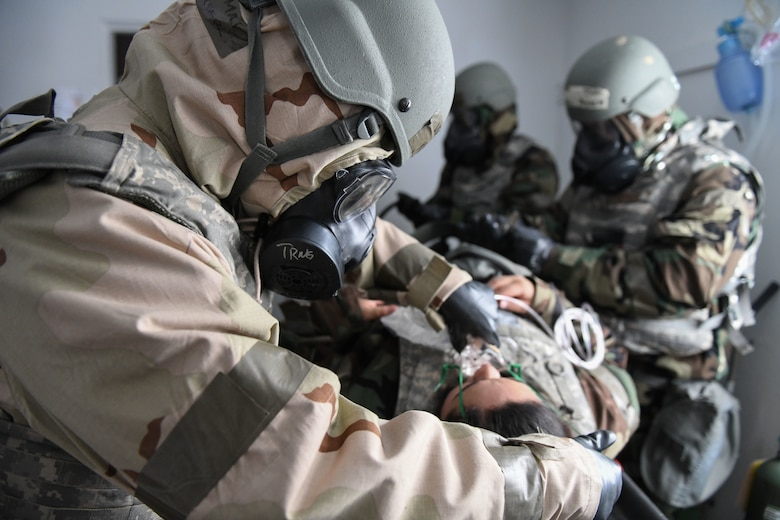 Airmen perform simulated medical treatment