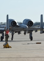 Senior Airman Kyle Jans, an avionics technician with the 442d Aircraft Maintenance Squadron specialist flight, signals a A-10 Thunderbolt II forward at Whiteman Air Force Base, Mo., Nov. 3, 2019. Before the aircraft can take off, the technicians test the radar warning receiving pits to ensure the missile warning capabilities on the aircraft are working properly.