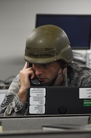 Tech. Sgt. Leeland Kimmel, a client systems technician with the 442d Communications Flight, recieves a simulated emergency call during Ozark Thunder 20-01 at Whiteman Air Force Base, Mo., Nov. 3, 2019. Ozark Thunder 20-01 is a 3-day wing-level readiness exercise that aims to test the wing's ability to survive and operate and perform mission essential tasks during contingency operations.