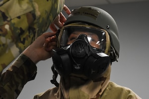 Tech. Sgt. Rebekah Underwood, a knowledge operations technician with the 442d Communications Flight, dons mission-oriented protective posture level 3 during a wing level readiness exercise, Ozark Thunder 20-01, at Whiteman Air Force Base, Mo., Nov. 3, 2019. During the exercise, Airmen participated in chemical warfare training and self-aid buddy care training while also performing their normal job duties to validate the wing's ability to perform mission essential tasks during contingency operations.