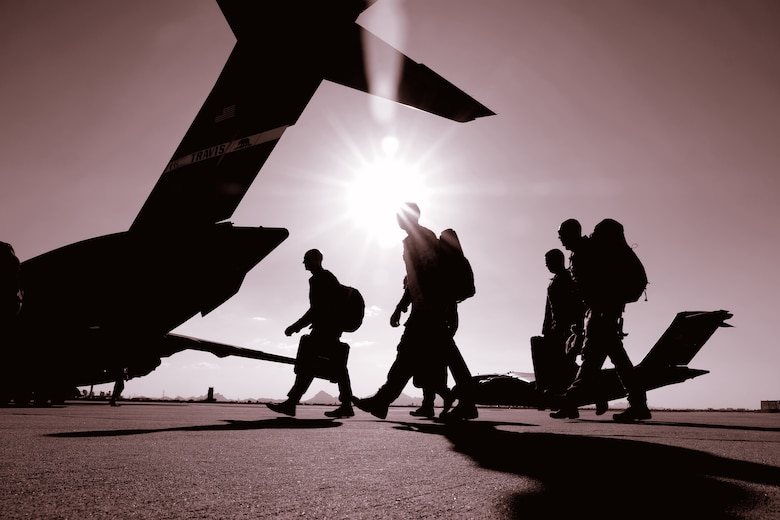 Members of the Reserve's 306th Rescue Squadron walk on the flight line towards a C-17 Globemaster III at Davis-Monthan Air Force Base, Arizona. The Reserve's Force Generation Center is responsible for aligning customer requirements with Reserve capabilities. (U.S. Air Force photo by Andre Trinidad.)