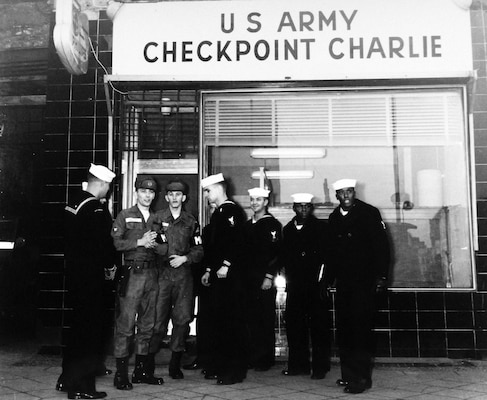 During Berlin Crisis of 1961, group of U.S. Naval Reservists talk to U.S. Army Soldiers who man Checkpoint Charlie, only American checkpoint along Berlin Wall (U.S. Navy Museum)