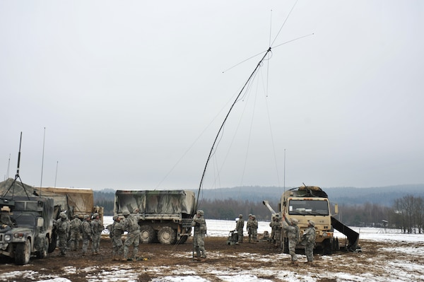 U.S. troopers, assigned to A Battery, Field Artillery Squadron, 2nd Cavalry Regiment, raise assembled radio antenna to enable field communications during Operation Chosin at 7th Army Joint Multinational Training Command's Grafenwoehr Training Area, Germany, January 28, 2015 (U.S. Army/Gertrud Zach)