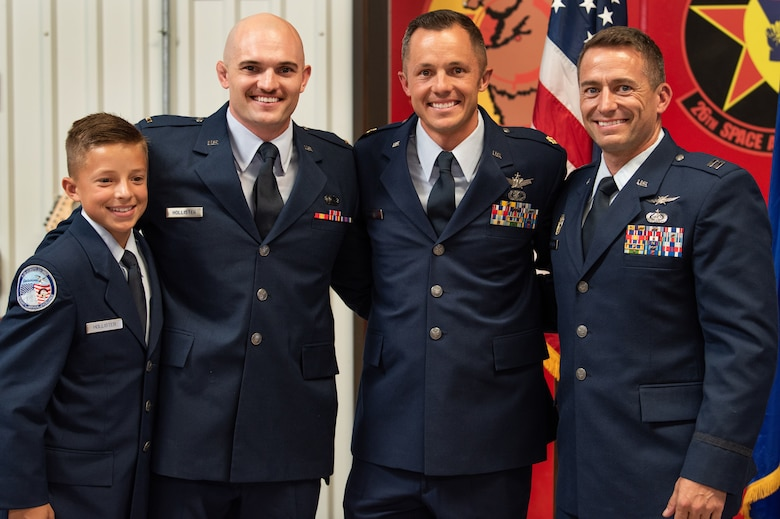 The three Hollister brothers and Scott's son, Trey, pose for a photo together during Scott's promotion ceremony.  (Staff Sgt. Laura Turner)