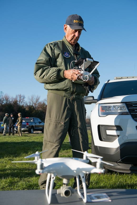 Lt. Col. Gordon Robertson, Delaware Civil Air Patrol director of operations for unmanned aircraft, prepares a commercial unmanned aerial system for flight during the Dover Operational Readiness for a Multi-domain Agile Response Exercise Nov. 13, 2019, at Dover Air Force Base, Del. The Delaware CAP provided pilots and commercial UASs to test the base's counter UAS capabilities. (U.S. Air Force photo by Mauricio Campino)