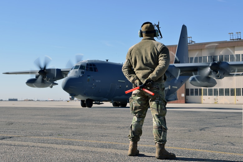 U.S. Air Force Airman 1st Class Paul Hinkle, 415th Aircraft Maintenance Unit crew chief, waits for the pilots of a MC-130J Commando II to complete preflight checks on the flight line at Kirtland Air Force Base, N.M., Nov. 14, 2019.  The 415th AMU is responsible for all maintenance on the MC-130J Commando II and HC-130J Combat King II aircraft assigned to keep them mission ready for the 415th Special Operation Squadron. (U.S. Air Force photo by Staff Sgt. Dylan Nuckolls)