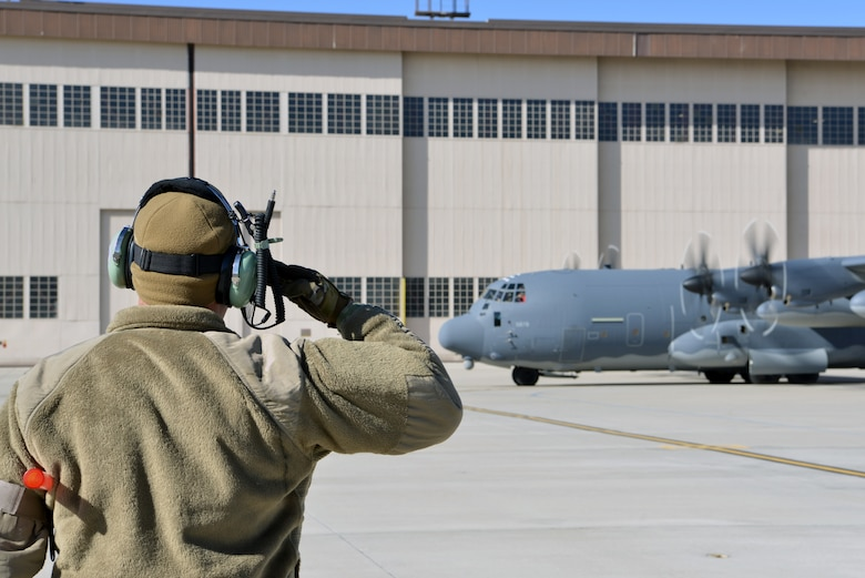 U.S. Air Force Airman 1st Class Paul Hinkle, 415th Aircraft Maintenance Unit crew chief, salutes the pilots of a MC-130J Commando II on the flight line at Kirtland Air Force Base, N.M., Nov. 14, 2019.  The 415 AMU is responsible for all maintenance on the MC-130J Commando II and HC-130J Combat King II aircraft assigned to keep them mission ready for the 415th Special Operation Squadron. (U.S. Air Force photo by Staff Sgt. Dylan Nuckolls)