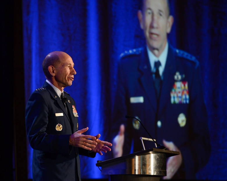 U.S. Air Force Gen. Mike Holmes, commander of Air Combat Command, speaks to Alamo Armed Forces Communication and Engineering Association Chapter Event attendees in San Antonio, Texas, Nov. 20, 2019. During the annual cyber- and technology-focused conference, Holmes discussed the importance of continuously evolving the U.S. military's multi-domain warfighter to combat tomorrow's threats. (U.S. Air Force photo by Sharon Singleton)