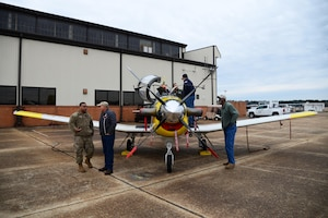 Members of Team BLAZE talk to Retiree Appreciation Day guests in front of a T-6 Texan II Nov. 14, 2019, on Columbus Air Force Base, Miss. During the event, retirees were treated with a free lunch buffet, raffle prizes, a medical expo and free flu shots. (U.S. Air Force photo by Airman 1st Class Jake Jacobsen)
