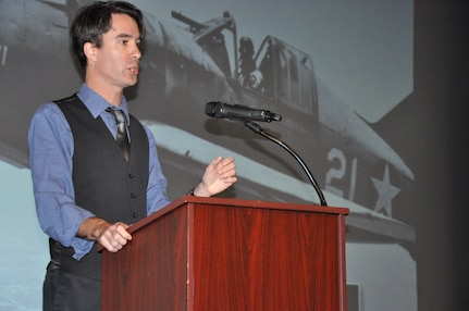 """IMAGE: DAHLGREN, Va. (Nov. 15, 2019) - Timothy Orr, an associate professor of military history at Old Dominion University, and co-author of """"Never Call Me A Hero:  A Legendary American Dive-Bomber Pilot Remembers the Battle of Midway,"""" stresses the importance of never forgetting the Battle of Midway warfighters. He shares their stories as a part of the Naval Heritage Command Lecture Series sponsored by the Naval Surface Warfare Center Dahlgren Division Integrated Combat Systems Department Nov. 15 at the base theater. """"No matter what they did, whether they came back or died out on the ocean, were wounded, or blew up in their plane – all of that is a story worth telling,"""" he said. """"It explains how the U.S. eventually triumphed over the empire of Japan in the Pacific War. It really shapes the world as we know it today."""""""
