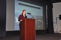 """IMAGE: DAHLGREN, Va. (Nov. 15, 2019) - Laura Orr, director of education at Hampton Roads Naval Museum in Norfolk, Va., and co-author of """"Never Call Me A Hero:  A Legendary American Dive-Bomber Pilot Remembers the Battle of Midway"""" highlights the stories of Midway warfighters as a part of the Naval Heritage Command Lecture Series sponsored by the Naval Surface Warfare Center Dahlgren Division Integrated Combat Systems Department Nov. 15 at the base theater."""