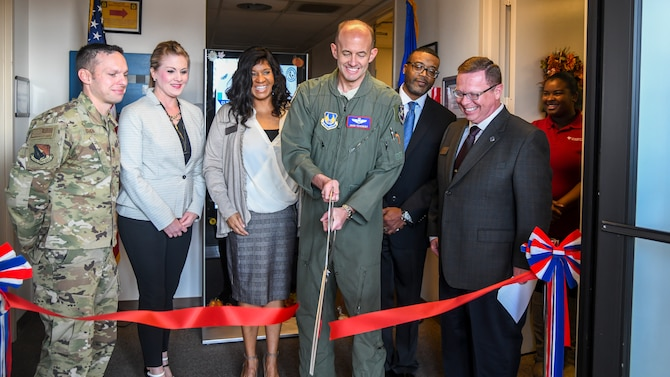 Brig. Gen. E. John Teichert, 412th Test Wing Commander, cuts a ribbon to officially open the National Test Center on Edwards Air Force Base, California, Nov. 20. The NTC, operated through the University of Phoenix, allows active-duty Airman and DoD civilians to take DANTES and CLEP tests on base. (Air Force photo by Giancarlo Casem)
