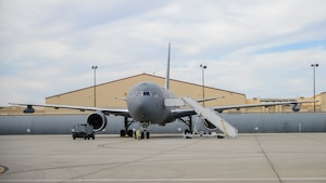 A KC-46 Pegasus is parked at a ramp at Edwards Air Force Base, California, with a Wing Aerial Refueling Pod (WARP) on each wing. The KC-46 Pegasus recently finished WARPs testing with an AV-8B and F-18D/G. The WARPs system allows the Pegasus to simultaneously refuel two aircraft via drogue chutes. (U.S. Air Force photo by Giancarlo Casem)