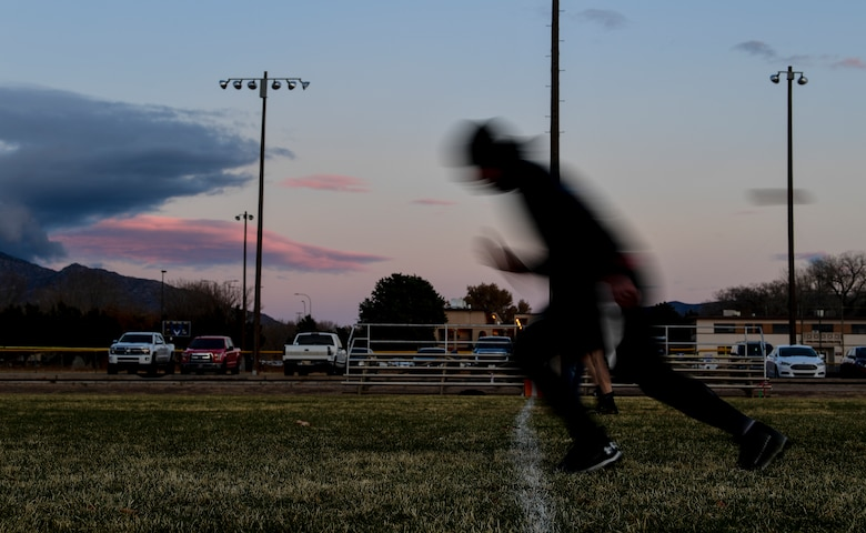 A photo of a football player running